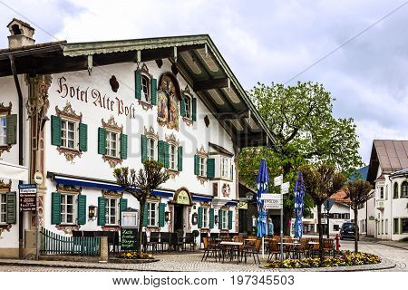 Bavaria, Germany - July 29, 2017: Painting house in village Oberammergau. Hotel and cafeteria