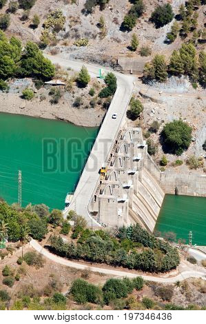 Aerial view at Hydroelectric power station and dum with car on it