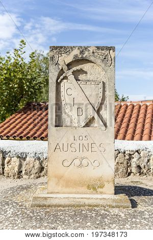 Camino del Cid signpost with a shield and a sword in Los Ausines, Burgos, Spain