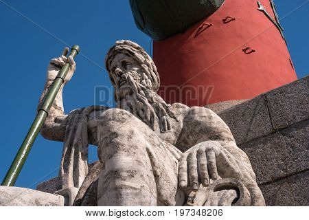 St. Petersburg. South rostral column. The male figure allegorically represents the Dnieper River. Fragment. Earlier rostral column represented the Navy and served as a beacon of glory.