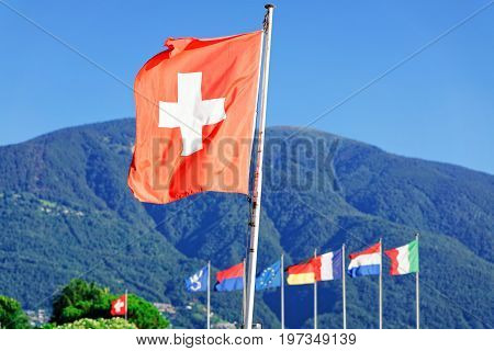 Flags In Ascona Ticino In Switzerland Alps On Background
