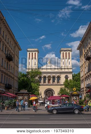 Saint Petersburg, Russia - June 17, 2017: Lutheran Church of saints Peter and Paul -St. Peter's Church-Located on Nevsky Prospekt. Pedestrians are on the sidewalk.