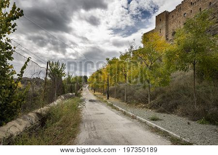 A road near the castle of siguenza in autumn, province of Guadalajara, Spain