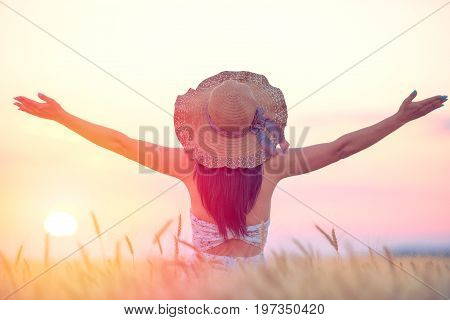 Woman feeling free happy and loved in a beautiful natural setting at sunset
