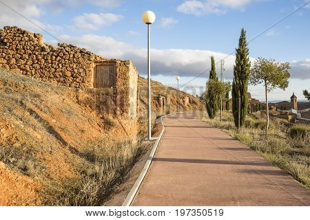 ruins of a rustic ancient house and a pedestrian path at Torrehermosa village, Zaragoza, Spain