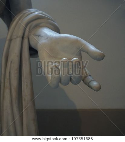 detail of the hand from ancient white marble statue National Archeological museum in Naples Italy