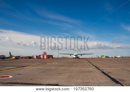Norilsk, Russia - June 27, 2017 Plane on the runway of Norilsk airport