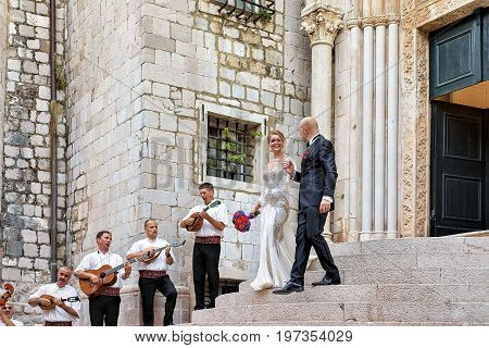 Bride Groom And Musicians At Church In Dubrovnik