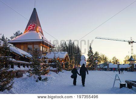 Couple In Santa Claus Village In Lapland Scandinavia