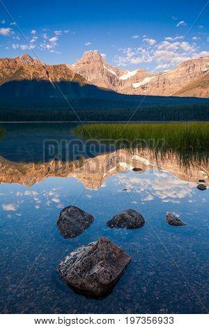 Howse Peak relected in Waterfowl Lake in Banff National Park, Alberta, Canada at sunrise
