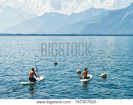 People On Standup Paddle Surfing Board Geneva Lake Swiss Riviera