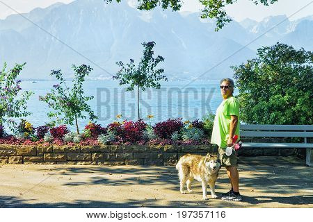 Man With Dog In Montreux Geneva Lake Swiss Riviera