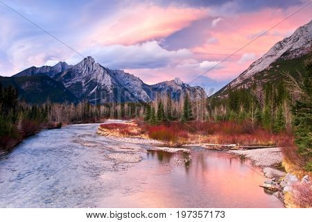 The Kananaskis River at sunset with Mount Lorette in the background, Alberta, Canada