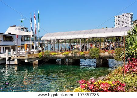 Excursion Ship And People On Pier On Geneva Lake Swiss