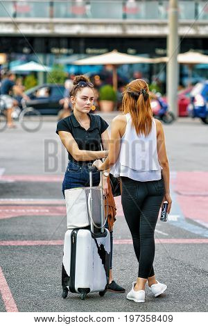 Young Girls With Trolley Bags At Central Railway Station Bern