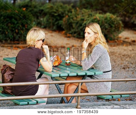 Woman Friends At Open Air Cafe In Bern Swiss