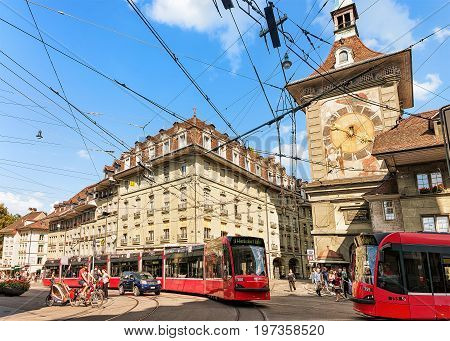 Running Trams And People On Marktgasse Street With Zytglogge Bern