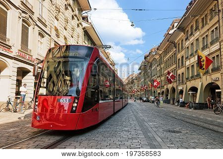Running Tram And People At Marktgasse Street In Bern