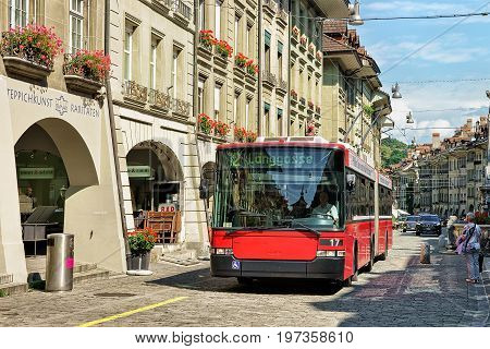 Running Tram And People At Kramgasse Street In Bern
