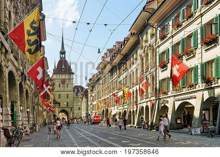 People On Marktgasse Street With Kafigturm Bern
