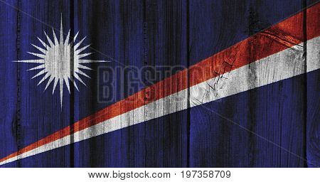 The Marshall Islands Flag Painted On Wooden Wall For Background