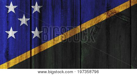 The Solomon Islands Flag Painted On Wooden Wall For Background