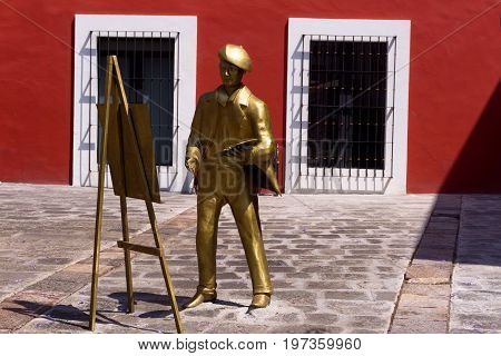 PUEBLA MEXICO - MARCH 2: Statue of a painter on the main square in the artists neighborhood in Puebla Mexico on March 2 2017