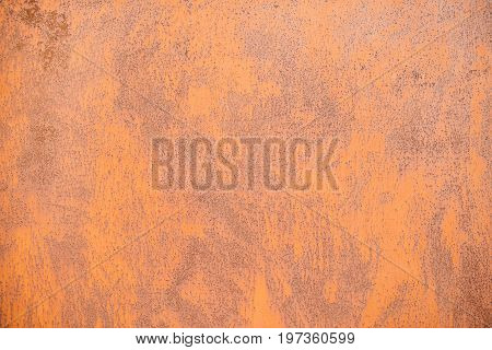 metal surface covered with rust and corrosion from the effects of moisture and air
