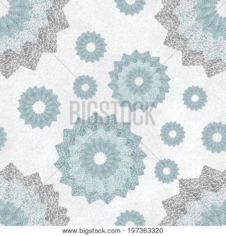 Seamless pattern of openwork lace round shapes. Geometric background with snowflake effect. Airy ornament in pale blue and light gray. Delicate, nice, soft, artistic image