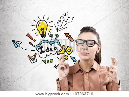 Woman With Crossed Fingers And Business Idea