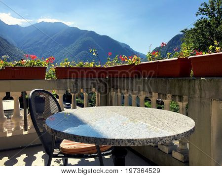 Table And Chair At The Balcony Veranda In Aurigeno
