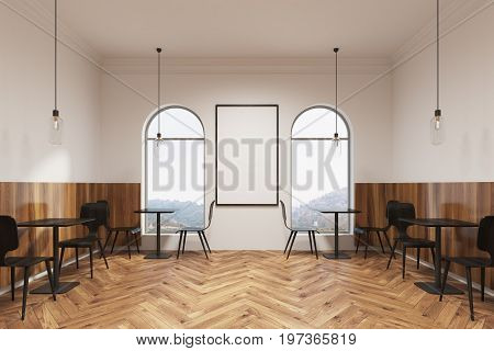 Modern black chairs are standing near square wooden tables in a coffee shop or a restaurant with a wooden floor white walls and a vertical poster. 3d rendering mock up