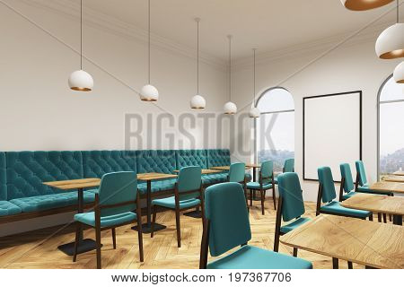 Blue green chairs and sofas are standing near square wooden tables in a coffee shop or a restaurant with a wooden floor white walls and a vertical poster. Side view. 3d rendering mock up