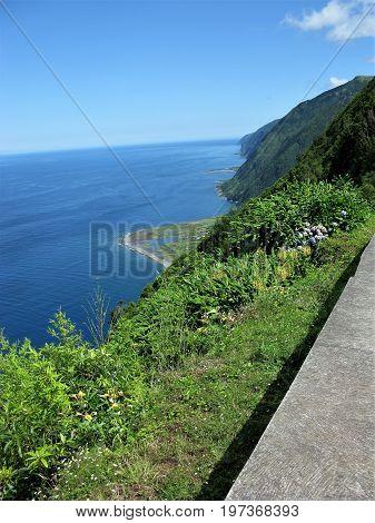 Coastline and faja from path, Sao Jorge island, The Azores