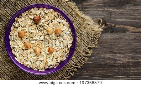 Oatmeal With Nuts Hazelnuts . Oatmeal On A Wooden Table. Oatmeal Top View. Healthy Food .