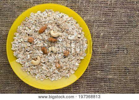 Oatmeal With Nuts (hazelnuts, Cashews, Almonds) . Oatmeal On A Wooden Table. Oatmeal Top View. Healt