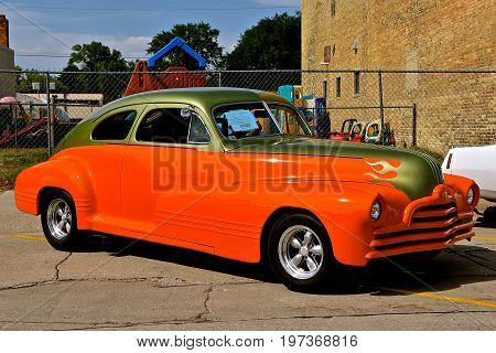 CASSELTON, NORTH DAKOTA, July 27, 2017: The annual Casselton Car Show which occurs the last Thursday of July features classic vehicles such as the 1947 Streamliner Pontiac.