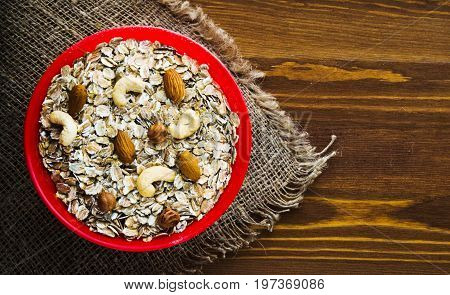Muesli With Nuts  (hazelnuts, Cashews, Almonds) . Muesli On A Wooden Table. Muesli Top View . Health