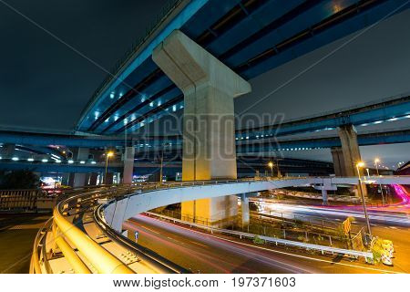 Traffic and over head highway at night