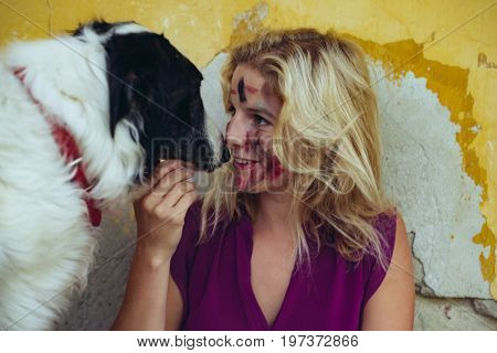 Woman and her dog playing