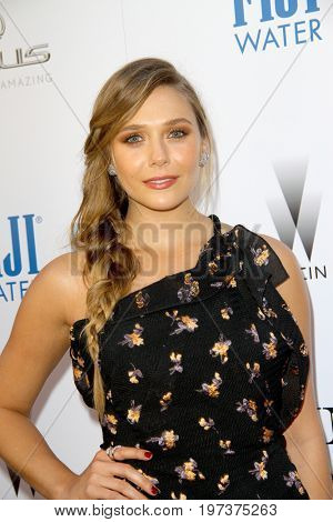 Elizabeth Olsen arrives at the Weinstein Company's
