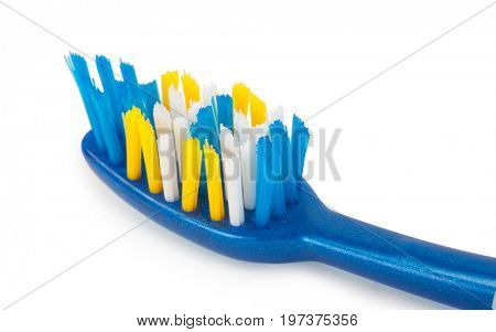 Closeup of toothbrush with uneven round tip bristle