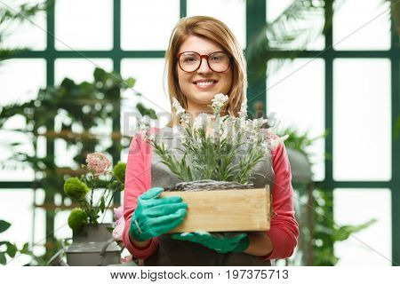 Smiling model with flower box