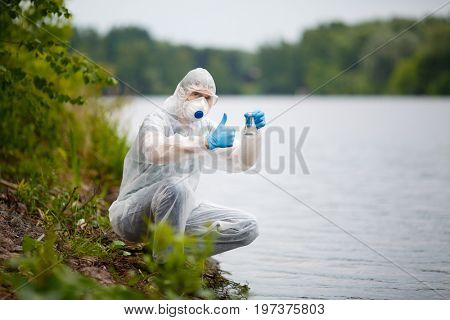Ecologist in respirator with bulb