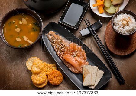 japan breakfast with tsukemono salmon, tofu,  matcha tea miso soup