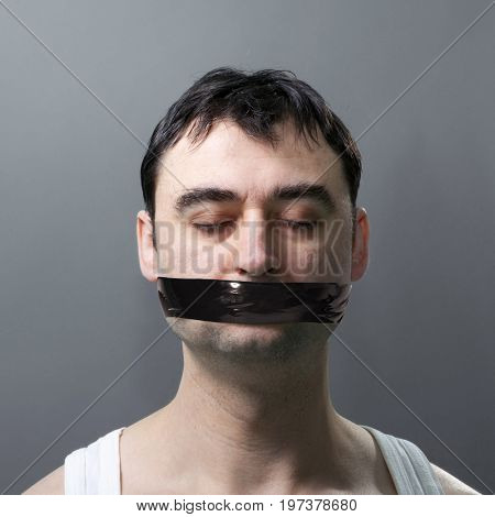 man's portrait with black duck tape on his face