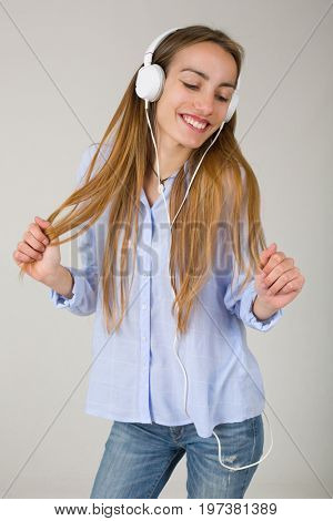 Beautiful young woman listen music with headphones