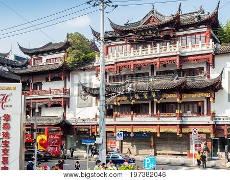 Shanghai, China - Nov 6, 2016: Building with faithfully restored traditional Chinese architecture along Fangbang Middle Road - Old Shanghai view.