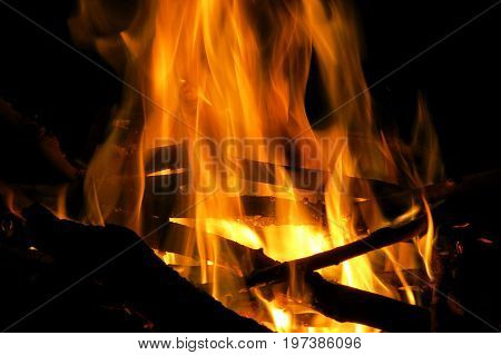 Fire flames in fireplace wood warm hot in cosy in winter