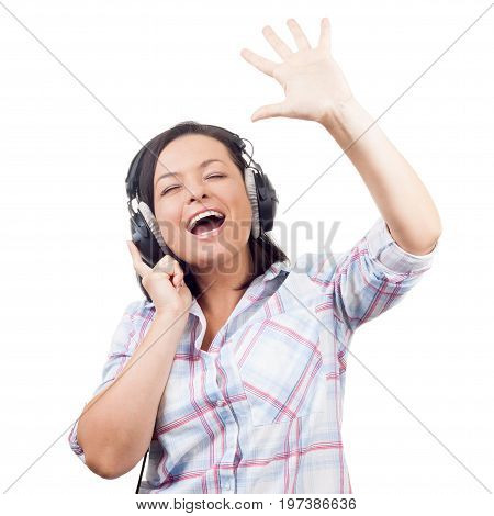 Happy Smiling Beautiful Young Woman Listening Music with Headphones and Singing on a white background